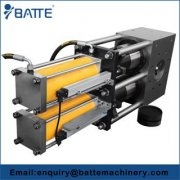What is fast plate screen changer made of